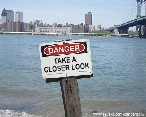danger sign that says, take a closer look